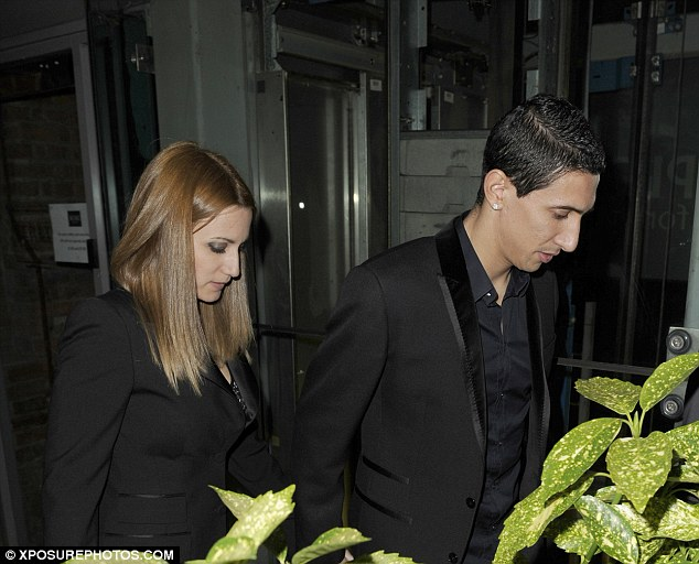 23B8EE4800000578-2859978-Angel_di_Maria_and_partner_Jorgelina_Cardoso_leave_their_first_M-a-40_1417677008381