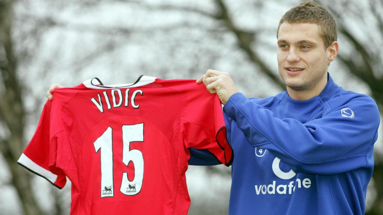 Nemanja Vidic poses with his Manchester
