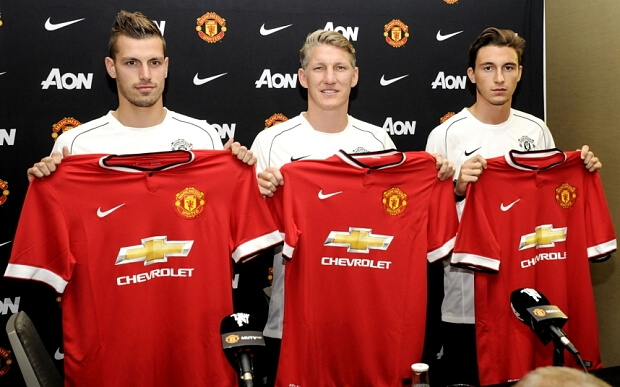 Mandatory Credit: Photo by Veda Jo Jenkins/REX Shutterstock (4903852v) Morgan Schneiderlin, Bastian Schweinsterger and Matteo Darmian pose with their jerseys Manchester United New Signings Press Conference, Bellevue, Washington, America - 15 Jul 2015