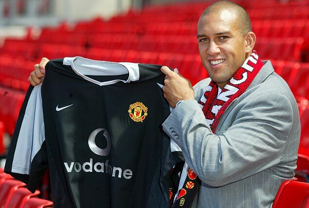 Manchester United's latest signing, American goalkeeper Tim Howard, is unveiled at a photocal at Manchester United's Old Trafford ground today July 15. Pa photo by Phil Noble