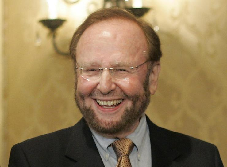 FILE - In this May 25, 2005 file photo, of Tampa Bay Buccaneers team owner and owner of Manchester United Malcolm Glazer smiles at the announcement of Tampa Bay being awarded the 2009 Super Bowl, during the NFL's Spring Meetings at the Ritz-Carlton Hotel in Washington. The FBI investigated threats of violence made against Malcolm Glazer and his family around the time the late owner of the Tampa Bay Buccaneers was acquiring English soccer club Manchester United, according to newly released documents. (AP Photo/J. Scott Applewhite, File)