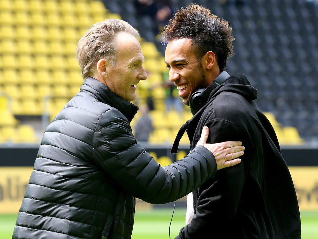 DORTMUND, GERMANY - MAY 09: (L-R) Hans Joachim Watzke, chairman of the board welcomes Pierre-Emerick Aubameyang of Dortmund prior to the Bundesliga match between Borussia Dortmund and Hertha BSC Bwerlin at Signal Iduna Park on May 9, 2015 in Dortmund, Germany. (Photo by Christof Koepsel/Bongarts/Getty Images)