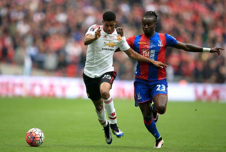"Manchester United's Marcus Rashford (left) and Crystal Palace's Pape N'Diaye Souare battle for the ball during the Emirates FA Cup Final at Wembley Stadium. PRESS ASSOCIATION Photo. Picture date: Saturday May 21, 2016. See PA story SOCCER Final. Photo credit should read: Mike Egerton/PA Wire. RESTRICTIONS: EDITORIAL USE ONLY No use with unauthorised audio, video, data, fixture lists, club/league logos or ""live"" services. Online in-match use limited to 75 images, no video emulation. No use in betting, games or single club/league/player publications."