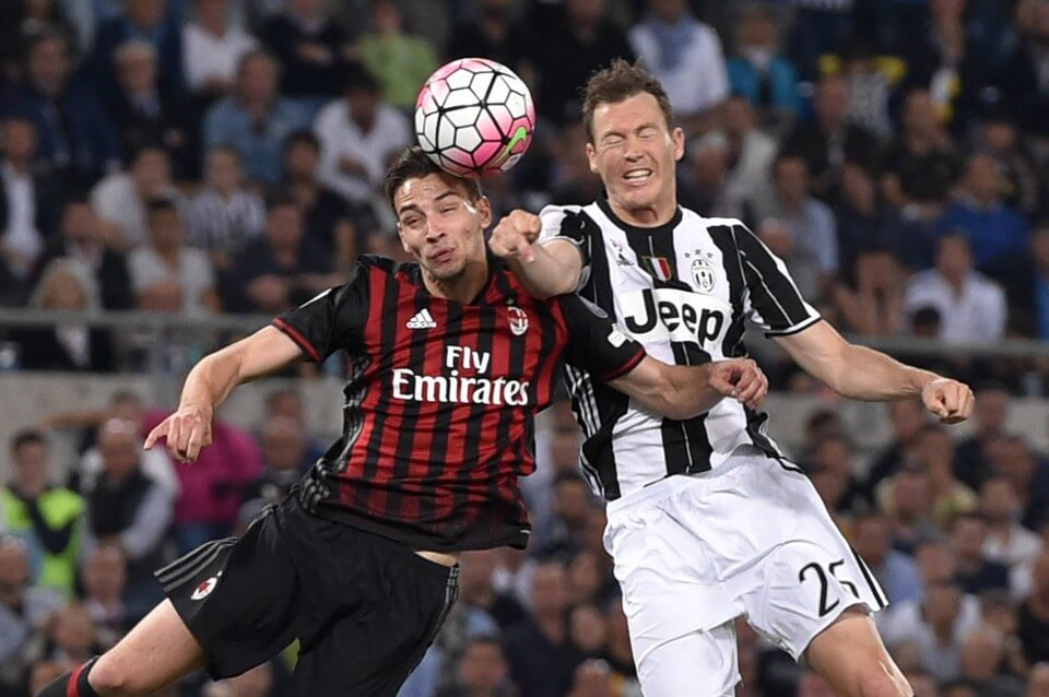 Juventus' defender from Switzerland Stephan Lichtsteiner (R) vies with AC Milan's defender from Italy Mattia De Sciglio during the Italian Tim Cup final football match AC Milan vs Juventus on May 21, 2016 at the Olympic Stadium in Rome. AFP PHOTO / TIZIANA FABITIZIANA FABI/AFP/Getty Images