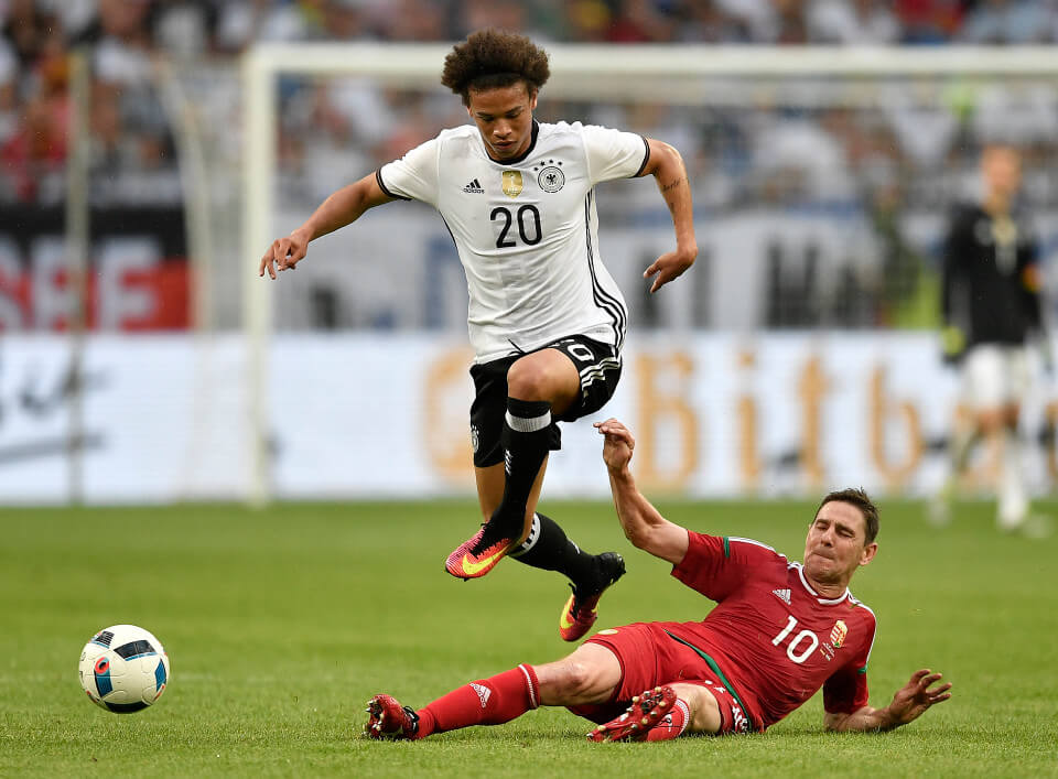 Germany¿s Leroy Sane jumps over Hungary¿s Zoltan Gera during the international friendly soccer match between Germany and Hungary in Gelsenkirchen, Germany, Saturday, June 4, 2016. (AP Photo/Martin Meissner)
