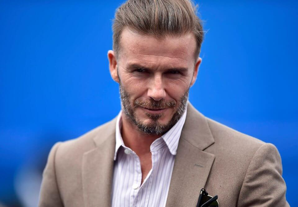 epa05364111 Former England national soccer team captain David Beckham arrives as a spectator on centre court at the Aegon Tennis Championships at the Queen's Club in London, Britain, 14 June 2016. The ATP World Tour 500 Tournament takes place from 13 to 19 June 2016. EPA/HANNAH MCKAY