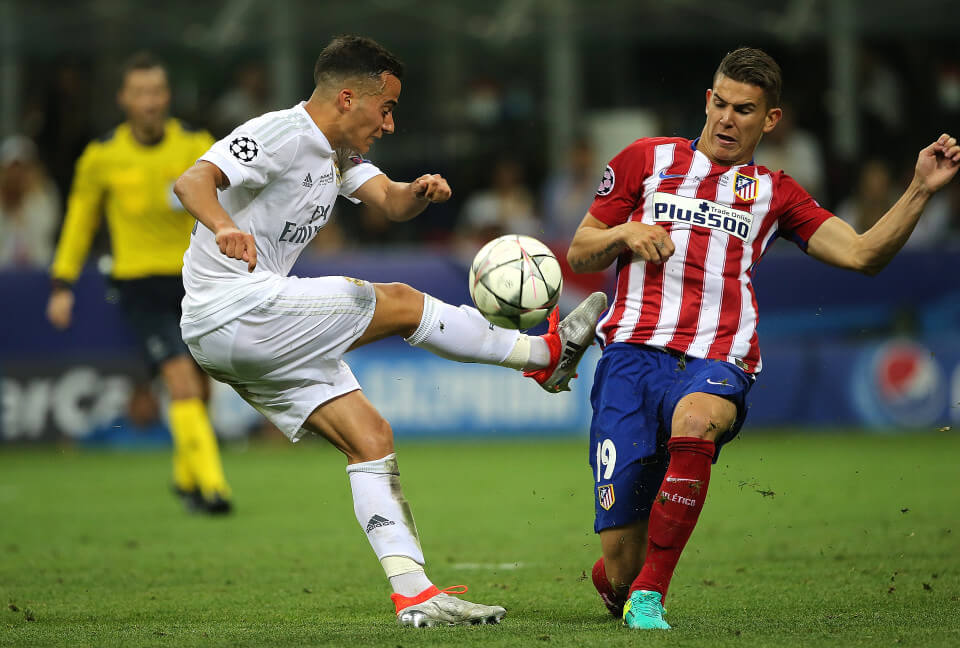 MILAN, ITALY - MAY 28: Lucas Hernandez of Atletico Madrid competes with Luca Vazquez of Real Madrid during the UEFA Champions League final match between Real Madrid and Club Atletico de Madrid at Stadio Giuseppe Meazza on May 28, 2016 in Milan, Italy. (Photo by Matthew Ashton - AMA/Getty Images)