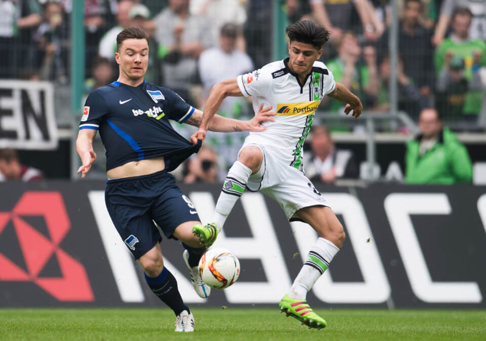 03 Apr 2016, Mönchengladbach, Rhineland, Germany --- Gladbach's Mahmoud Dahoud (r) and Hertha's Alexander Baumjohann in action during German Bundesliga soccer match between Borussia Moenchengladbach and Hertha BSC at the stadium at Borussia-Park in Moenchengladbach, Germany, 3 April 2016. PHOTO: BERND THISSEN/dpa (EMBARGO CONDITIONS - ATTENTION: Due to the accreditation guidlines, the DFL only permits the publication and utilisation of up to 15 pictures per match on the internet and in online media during the match.) --- Image by © Bernd Thissen/dpa/Corbis