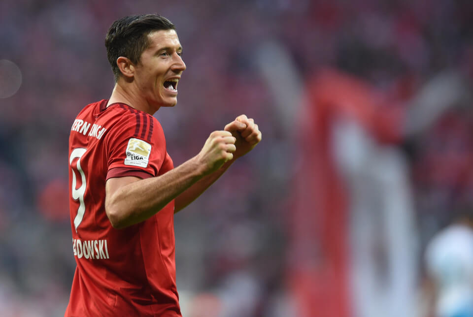 (FILES) This file photo taken on April 16, 2016 shows Bayern Munich's Polish striker Robert Lewandowski celebrating scoring the 2-0 goal during the German first division Bundesliga football match FC Bayern Munich vs Schalke 04 in Munich, southern Germany. / AFP PHOTO / CHRISTOF STACHECHRISTOF STACHE/AFP/Getty Images