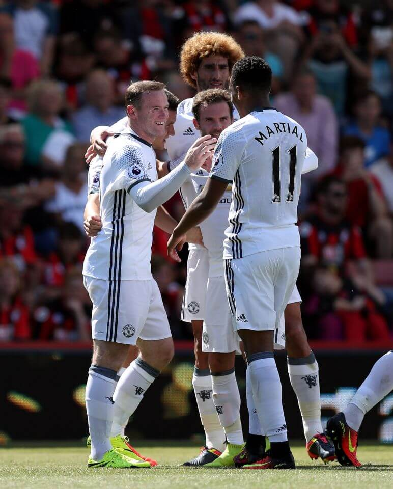 "Manchester United's Wayne Rooney (left) celebrates scoring his side's second goal of the game with his team-mates during the Premier League match at the Vitality Stadium, Bournemouth. PRESS ASSOCIATION Photo. Picture date: Sunday August 14, 2016. See PA story SOCCER Bournemouth. Photo credit should read: Andrew Matthews/PA Wire. RESTRICTIONS: EDITORIAL USE ONLY No use with unauthorised audio, video, data, fixture lists, club/league logos or ""live"" services. Online in-match use limited to 75 images, no video emulation. No use in betting, games or single club/league/player publications."