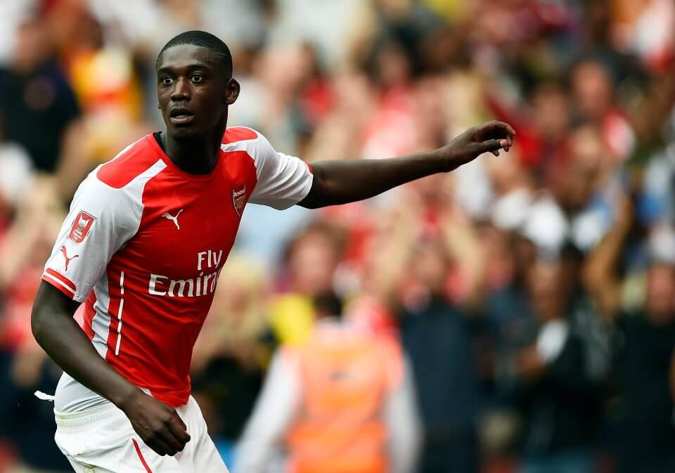 Arsenal's Yaya Sanogo does a dance as he celebrates after scoring his third goal against Benfica during their Emirates Cup soccer match at the Emirates stadium in London August 2, 2014. REUTERS/Dylan Martinez (BRITAIN - Tags: SPORT SOCCER)