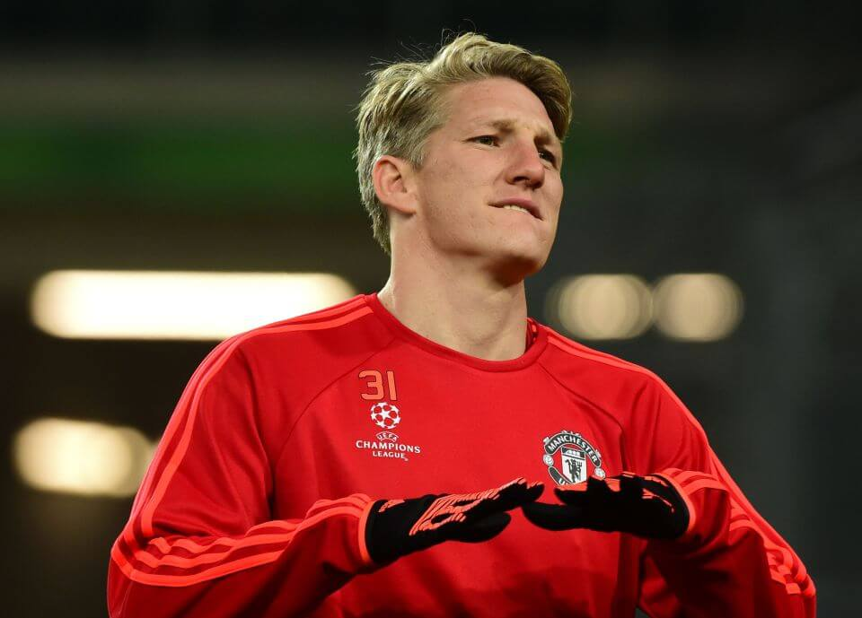 (FILES) This file photo taken on December 07, 2015 shows Manchester United's German midfielder Bastian Schweinsteiger warming up during a training session in Wolfsburg, central Germany, on December 7, 2015. Four-time African player of the year Yaya Toure is out in the cold at his club Manchester City after Pep Guardiola said he would not play until his agent apologised for remarks he made. AFP Sports looks at five other examples of players who either refused to play or were barred by the manager from doing so: / AFP PHOTO / JOHN MACDOUGALL / TO GO WITH AFP STORY BY PIRATE IRWINJOHN MACDOUGALL/AFP/Getty Images