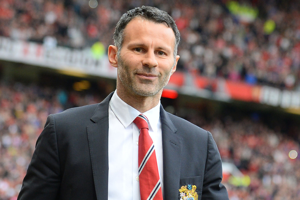 Manchester United's caretaker manager Ryan Giggs is pictured before the start of the English Premier League football match between Manchester United and Norwich City at Old Trafford in Manchester, northwest England, on April 26, 2014. AFP PHOTO/ANDREW YATES RESTRICTED TO EDITORIAL USE. NO USE WITH UNAUTHORIZED AUDIO, VIDEO, DATA, FIXTURE LISTS, CLUB/LEAGUE LOGOS OR LIVE SERVICES. ONLINE IN-MATCH USE LIMITED TO 45 IMAGES, NO VIDEO EMULATION. NO USE IN BETTING, GAMES OR SINGLE CLUB/LEAGUE/PLAYER PUBLICATIONS (Photo credit should read ANDREW YATES/AFP/Getty Images)