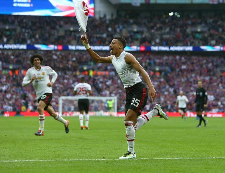 Jesse Lingard of Manchester United celebrates scoring his sides second goal during the Emirates FA Cup Final match at the Wembley Stadium